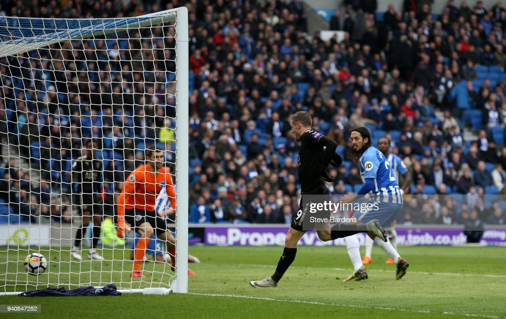 Jamie Vardy of Leicester City scores his sides second goal during the Premier League match between Brighton and Hove Albion and Leicester City at Amex Stadium on March 31, 2018 in Brighton, England.