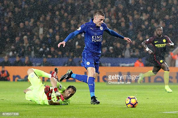 Jamie Vardy of Leicester City scores his sides third goal past Claudio Bravo of Manchester City during the Premier League match between Leicester...