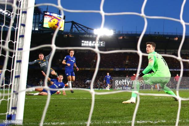 Jamie Vardy of Leicester City scores his team's first goal as Kepa Arrizabalaga of Chelsea looks on during the Premier League match between Chelsea...