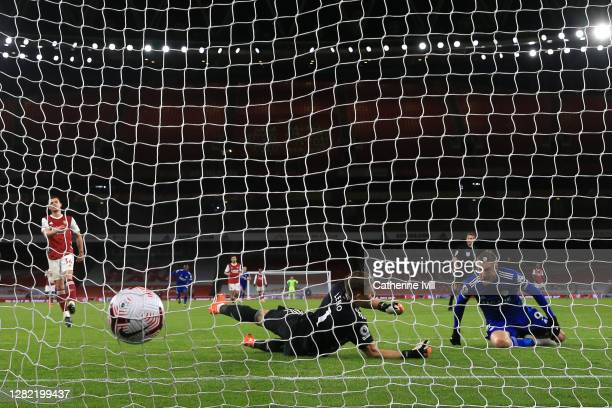 Jamie Vardy of Leicester City scores his team's first goal Bernd Leno of Arsenal during the Premier League match between Arsenal and Leicester City...
