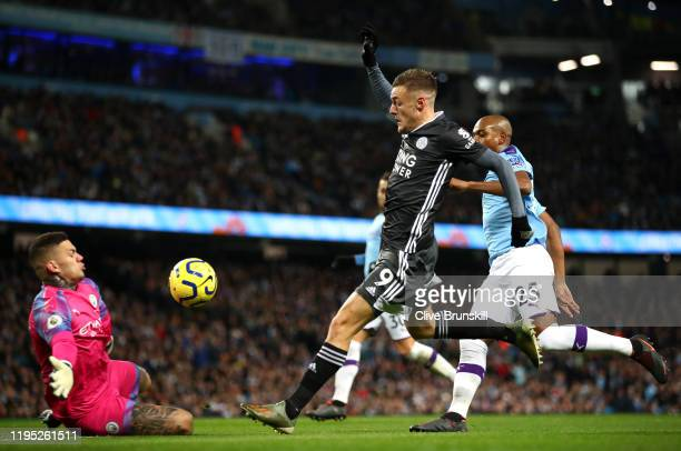Jamie Vardy of Leicester City scores his team's first goal during the Premier League match between Manchester City and Leicester City at Etihad...