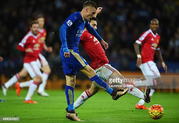 Jamie Vardy of Leicester City scores his team's first goal during the Barclays Premier League match between Leicester City and Manchester United at...