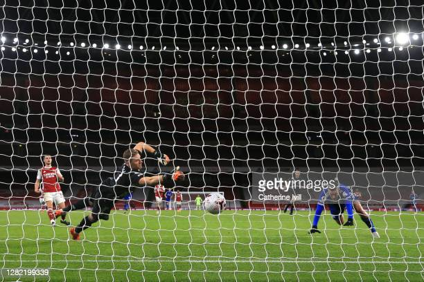Jamie Vardy of Leicester City scores his team's first goal past Bernd Leno of Arsenal during the Premier League match between Arsenal and Leicester...