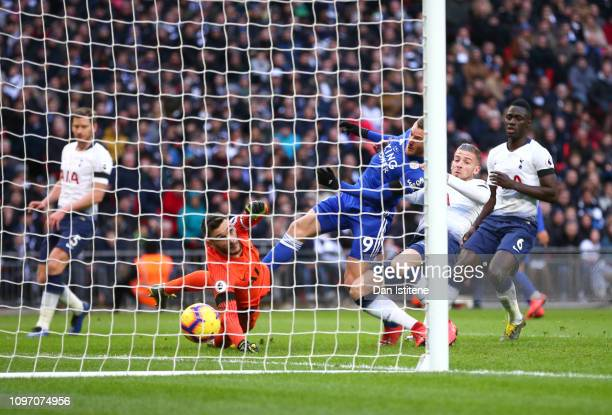 Jamie Vardy of Leicester City scores his team's first goal past Hugo Lloris of Tottenham Hotspur as he is challenged by Toby Alderweireld of...