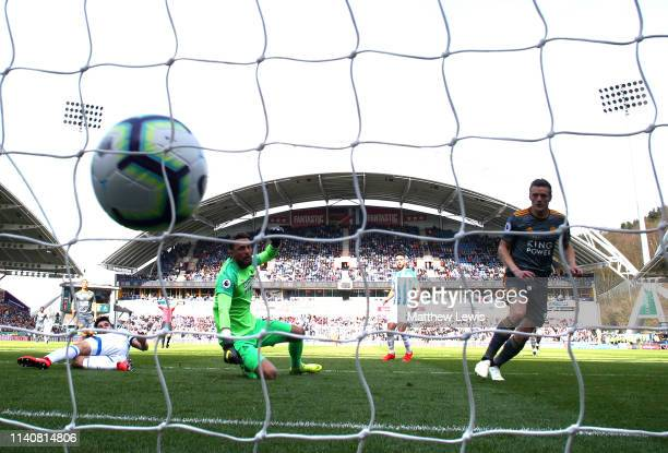 Jamie Vardy of Leicester City scores his team's second goal past Ben Hamer of Huddersfield Town during the Premier League match between Huddersfield...