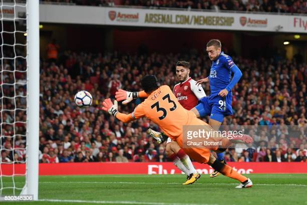 Jamie Vardy of Leicester City scores his team's second goal past goalkeeper Petr Cech of Arsenal during the Premier League match between Arsenal and...