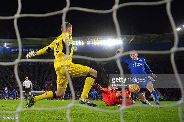 Jamie Vardy of Leicester City scores his team's second goal past Simon Mignolet of Liverpool during the Barclays Premier League match between...
