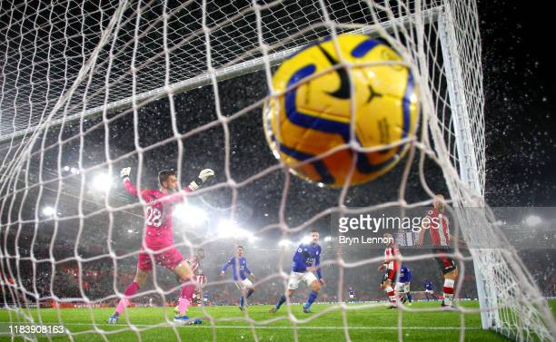 Jamie Vardy of Leicester City scores his team's seventh goal past Angus Gunn of Southampton during the Premier League match between Southampton FC...
