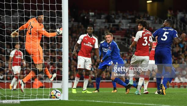 Jamie Vardy of Leicester City scores his team's third goalduring the Premier League match between Arsenal and Leicester City at the Emirates Stadium...