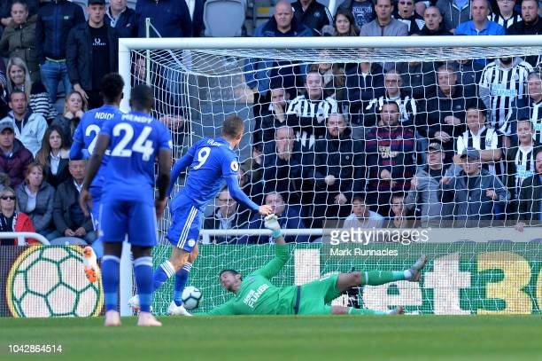 Jamie Vardy of Leicester City scores the opening goal from a penalty during the Premier League match between Newcastle United and Leicester City at...