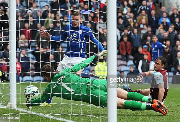 Jamie Vardy of Leicester City scores their first goal past Thomas Heaton of Burnley during the Barclays Premier League match between Burnley and...
