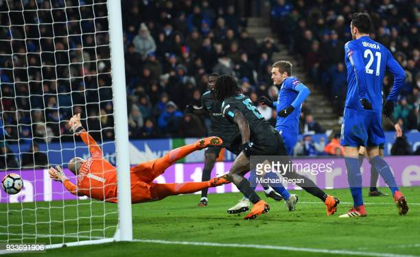 Jamie Vardy of Leicester City scores their first goal past Willy Caballero of Chelsea during The Emirates FA Cup Quarter Final match between...