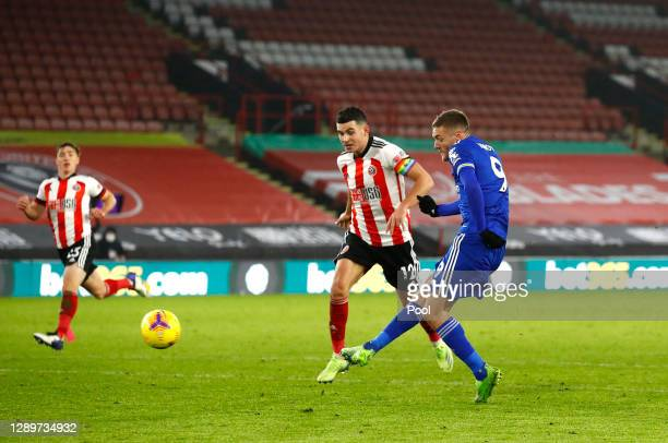 Jamie Vardy of Leicester City scores their sides second goal whilst under pressure from John Egan of Sheffield United during the Premier League match...