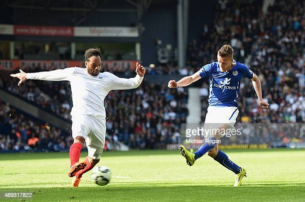 Jamie Vardy of Leicester City scorestheir third goal past Joleon Lescott of West Brom during the Barclays Premier League match between West Bromwich...