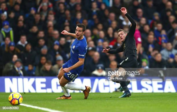 Jamie Vardy of Leicester City shoots as Cesar Azpilicueta of Chelsea attempts to block during the Premier League match between Chelsea and Leicester...