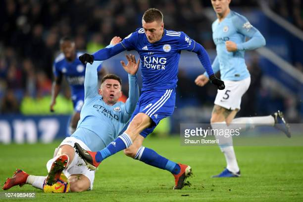 Jamie Vardy of Leicester City shoots as he is challenged by Aymeric Laporte of Manchester City during the Premier League match between Leicester City...