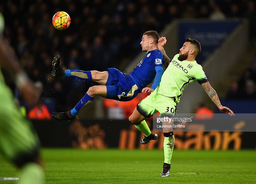 Jamie Vardy of Leicester City shoots at goal under pressure from Nicolas Otamendi of manchester City during the Barclays Premier League match between Leicester City and Manchester City at The King Power Stadium on December 29, 2015 in Leicester, England.