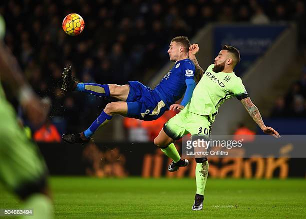 Jamie Vardy of Leicester City shoots at goal under pressure from Nicolas Otamendi of manchester City during the Barclays Premier League match between...