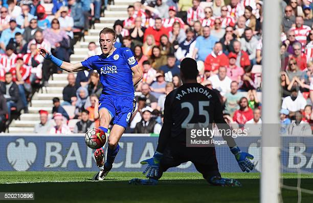 Jamie Vardy of Leicester City shoots past goalkeeper Vito Mannone of Sunderland as he scores their first goal during the Barclays Premier League...