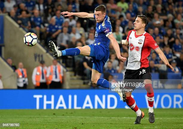 Jamie Vardy of Leicester City shoots while under pressure from Jan Bednarek of Southampton during the Premier League match between Leicester City and...