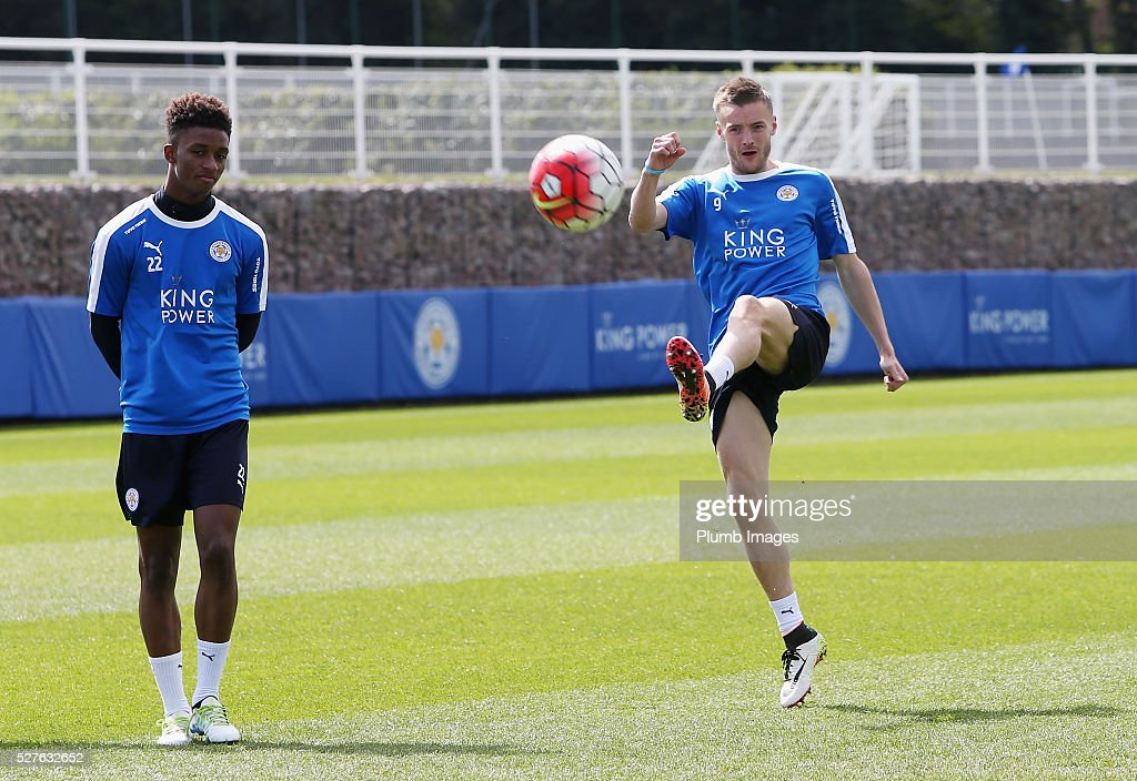 Jamie Vardy (R) of Leicester City shoots with Demarai Gray during a Leicester City training session at Belvoir Drive Training Ground on May 3, 2016 in Leicester, England.
