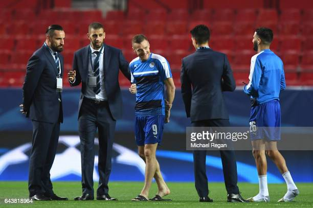 Jamie Vardy of Leicester City smiles as he talks with teammates before the UEFA Champions League Round of 16 first leg match between Sevilla FC and...