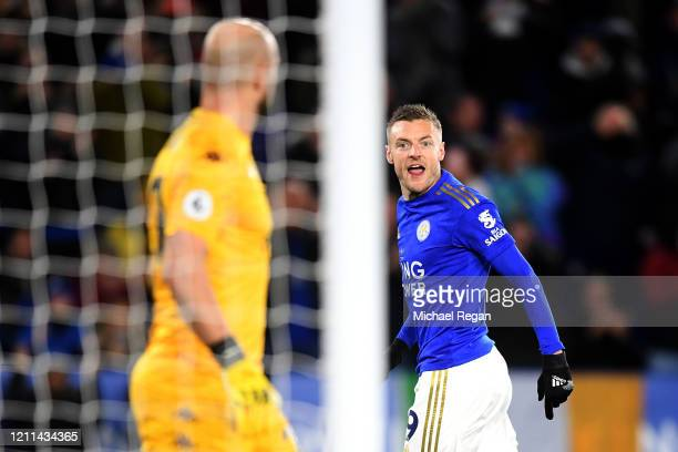 Jamie Vardy of Leicester City speaks to Goalkeeper Pepe Reina of Aston Villa after he scores a penalty during the Premier League match between...