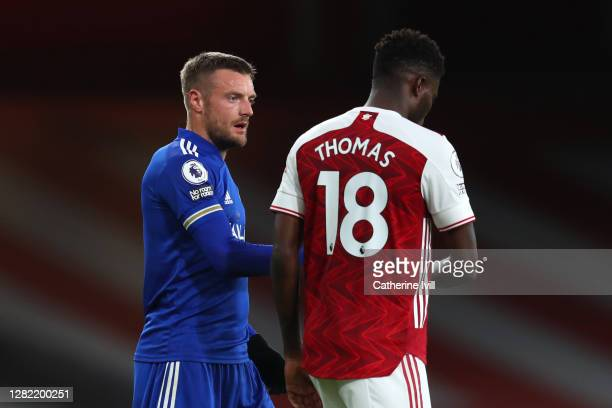 Jamie Vardy of Leicester City speaks to Thomas Partey of Arsenal following the Premier League match between Arsenal and Leicester City at Emirates...