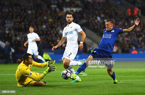 Jamie Vardy of Leicester City stretches to get to the ball before Lukasz Fabianski of Swansea City during the Premier League match between Leicester...