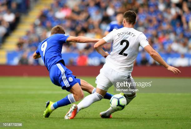 Jamie Vardy of Leicester City tackles Matt Doherty of Wolverhampton Wanderers leading to being shown a red card during the Premier League match...