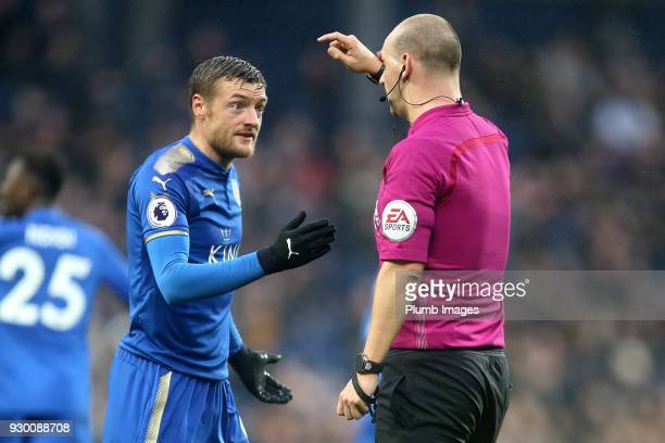 Jamie Vardy of Leicester City talks to referee Bobby Madley during the Premier League match between West Bromwich Albion and Leicester City at The...