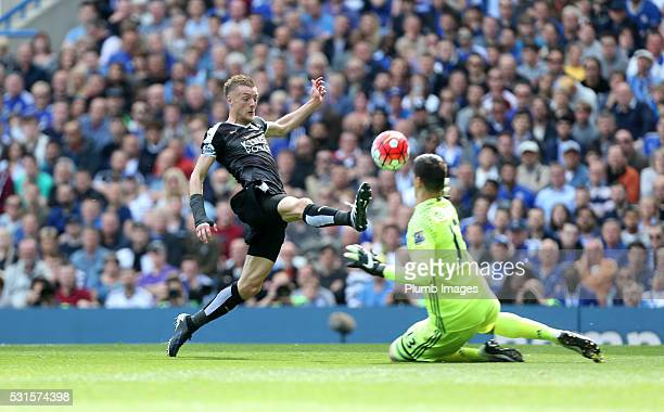 Jamie Vardy of Leicester City tries to lift the ball over Thibaut Courtois of Chelsea during the Premier League match between Chelsea and Leicester...