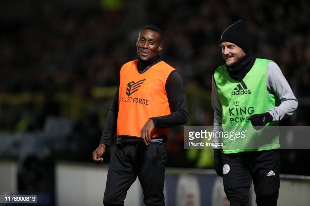 Jamie Vardy of Leicester City warms up former fox Lloyd Dyer of Burton Albion during the Carabao Cup Round of 16 match between Burton Albion and...