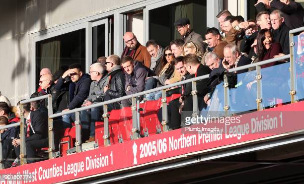 Jamie Vardy of Leicester City watches on from the stands with his wife Rebekah Vardy during The Emirates FA Cup Third Round tie between Fleetwood...