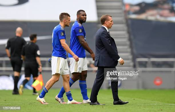 Jamie Vardy of Leicester City Wes Morgan of Leicester City and Brendan Rodgers Manager of Leicester City walk off the pitch after the Premier League...