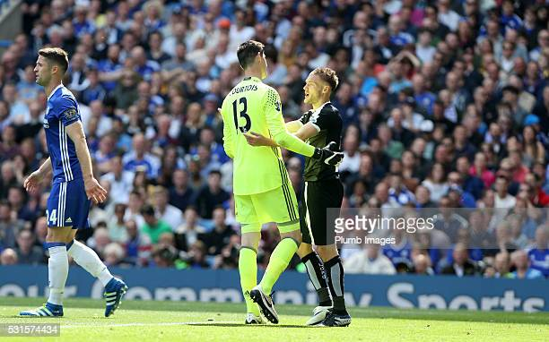 Jamie Vardy of Leicester City with Thibaut Courtois of Chelsea during the Premier League match between Chelsea and Leicester City at Stamford Bridge...