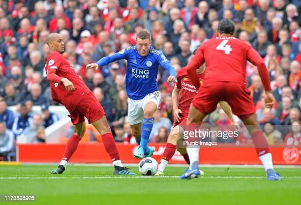 Jamie Vardy of Leicester City with Virgil van Dijk of Liverpool during the Premier League match between Liverpool FC and Leicester City at Anfield on...
