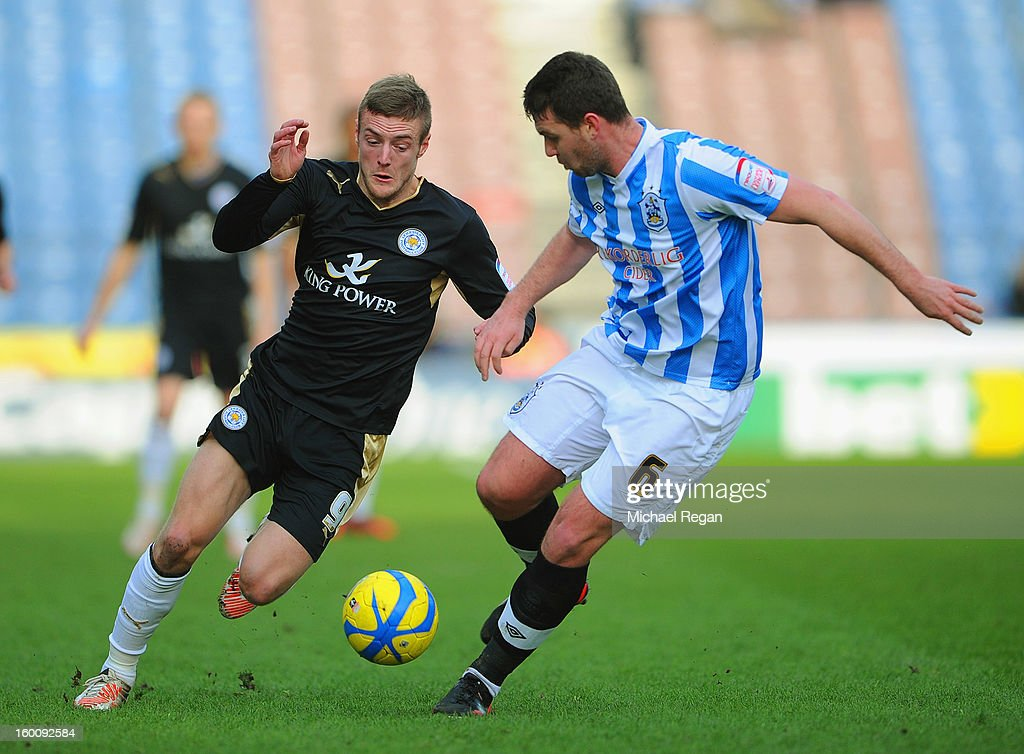 Jamie Vardy of Leicester in action with Anthony Gerrard of Huddersfield during the FA Cup Fourth Round match between Huddersfield Town and Leicester City at the Galpharm Stadium on January 26, 2013 in Huddersfield, England.