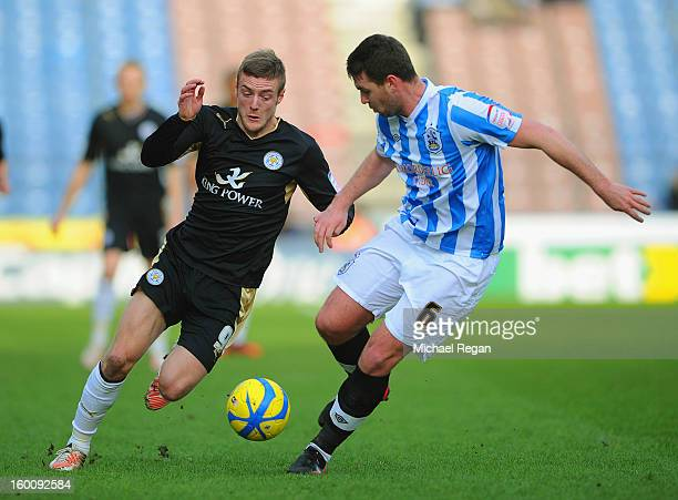 Jamie Vardy of Leicester in action with Anthony Gerrard of Huddersfield during the FA Cup Fourth Round match between Huddersfield Town and Leicester...