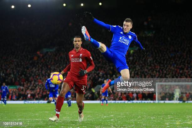 Jamie Vardy of Leicester leaps for the ball alongside Joel Matip of Liverpool during the Premier League match between Liverpool and Leicester City at...