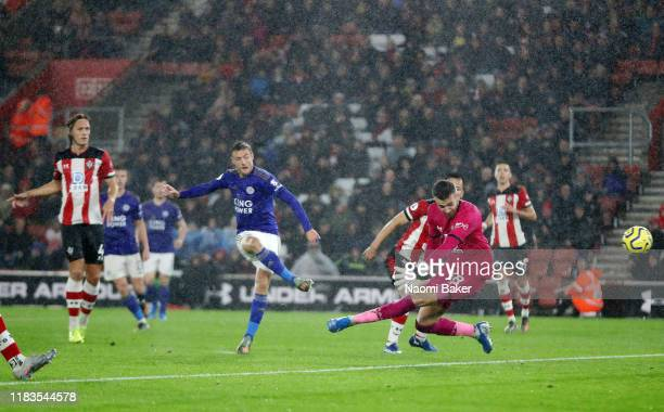 Jamie Vardy of Leicster City scores his teams 5th goal past Angus Gunn of Southampton during the Premier League match between Southampton FC and...