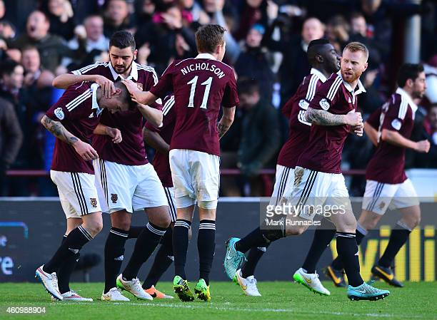 Jamie Walker of Hearts celebrates scoring a goal during the first half of the Scottish Championship match between Heart of Midlothian FC and...