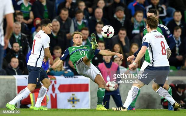 Jamie Ward of Northern Ireland and Stefan Johansen of Norway during the FIFA 2018 World Cup Qualifier between Northern Ireland and Norway at Windsor...