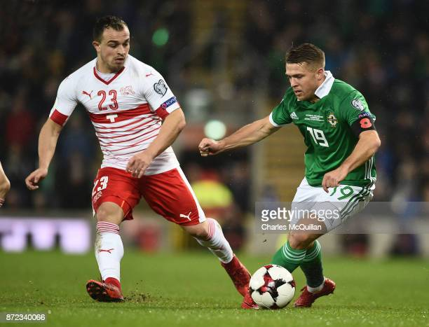 Jamie Ward of Northern Ireland and Xherdan Shaqiri of Switzerland during the FIFA 2018 World Cup Qualifier PlayOff first leg between Northern Ireland...