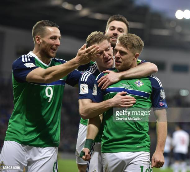 Jamie Ward of Northern Ireland celebrates scoring with team mates during the FIFA 2018 World Cup Qualifier between Northern Ireland and Norway at...