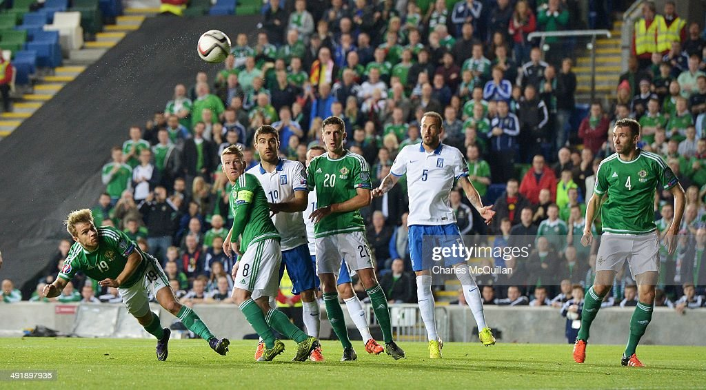 Jamie Ward (L) of Northern Ireland heads at goal during the Euro 2016 Group F international football match against Greece at Windsor Park on October 8, 2015 in Belfast, Northern Ireland.