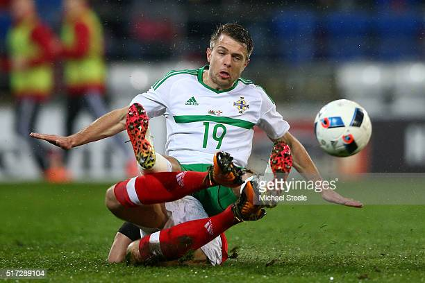 Jamie Ward of Northern Ireland is tackled by Adam Matthews of Wales during the international friendly match between Wales and Northern Ireland at the...