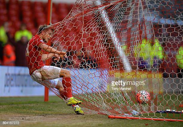 Jamie Ward of Nottingham Forest gets tangled in the goal net as his teammate Oliver Burke scores the opening goal during The Emirates FA Cup Third...
