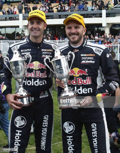Jamie Whincup and Paul Dumbrell driver sof the Red Bull Holden Racing Team Holden Commodore ZB pose after winning the Sandown 500 at Sandown...
