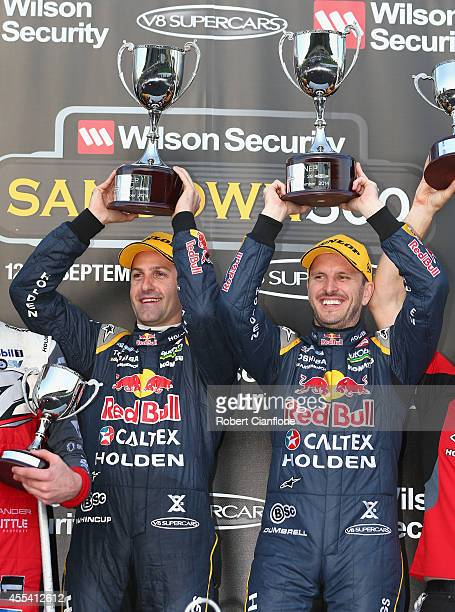 Jamie Whincup and Paul Dumbrell drivers the Red Bull Racing Australia Holden celebrate after they combined to win the Sandown 500 which is race 29 of...